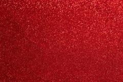ύφασμα λαμπρό Το κόκκινο ακτινοβολεί ανασκόπηση Στοκ Φωτογραφίες