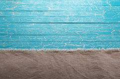 Ύφασμα καμβά σε ένα μπλε υπόβαθρο Στοκ εικόνες με δικαίωμα ελεύθερης χρήσης
