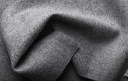 Ύφασμα τουίντ, υφαντικό υπόβαθρο ψαροκόκκαλων μαλλιού γκρίζο Στοκ Φωτογραφία
