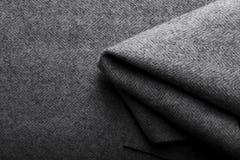 Ύφασμα τουίντ, υφαντικό υπόβαθρο ψαροκόκκαλων μαλλιού γκρίζο Στοκ Εικόνες