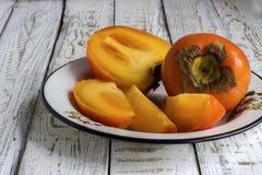 Ώριμα γλυκά persimmons Στοκ Εικόνες