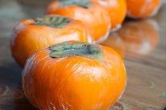 Ώριμα persimmons της Ιαπωνίας Στοκ Φωτογραφίες