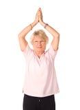 ώριμη γιόγκα γυναικών θέση&sigma Στοκ φωτογραφία με δικαίωμα ελεύθερης χρήσης