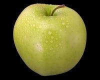 Η πράσινη Apple στο μαύρο υπόβαθρο Στοκ Φωτογραφίες