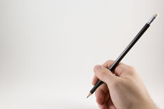 δώστε το μολύβι στοκ φωτογραφία