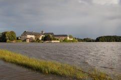 Аббатство Paimpont осмотренное от озера Стоковые Фотографии RF