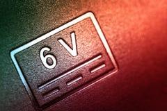 Аббревиатура 6 вольт на теле стоковая фотография