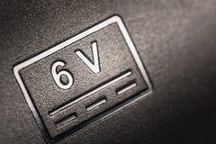 Аббревиатура 6 вольт на теле стоковые фотографии rf
