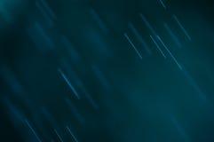 Абстрактная голубая предпосылка, понижаясь падения воды Стоковая Фотография
