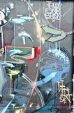 Абстрактная деталь граффити на кирпичной стене Стоковые Фото