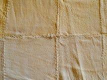 Абстрактная желтая мягкая предпосылка текстуры шамуа leathe Стоковая Фотография