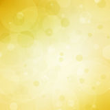 Абстрактная желтая предпосылка с светами пузыря bokeh и белым разбивочным copyspace Стоковое фото RF
