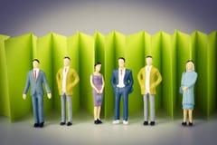 Абстрактная загородка зеленой книги на белизне с группой в составе зрелые люди Стоковые Изображения RF