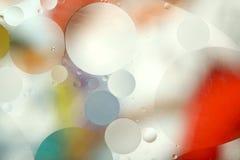 абстрактная запачканная предпосылка Изображение красных, голубых, серых и желтых кругов различных размеров стоковая фотография