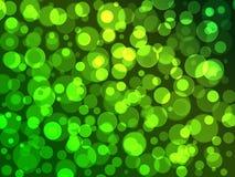 Абстрактная зеленая предпосылка, предпосылка рождества белых светов пузыря, предпосылка элемента дизайна круга зеленого цвета све стоковая фотография