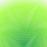 Абстрактная зеленая предпосылка с белыми треугольниками Стоковые Фото