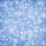 абстрактная зима рождества bokeh предпосылки Стоковая Фотография