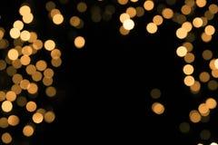 Абстрактная искра золота на темной предпосылке Стоковая Фотография