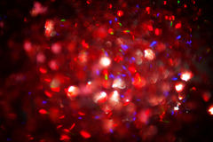Абстрактная красная мерцанная предпосылка рождества стоковые фото