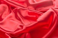 Абстрактная красная предпосылка ткани сатинировки Стоковое Фото