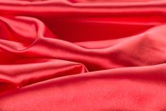 Абстрактная красная предпосылка ткани сатинировки Стоковые Изображения