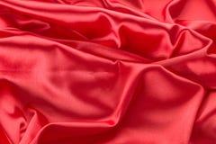 Абстрактная красная предпосылка ткани сатинировки Стоковая Фотография RF