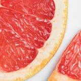 Абстрактная красная предпосылка с цитрусовыми фруктами Стоковые Изображения