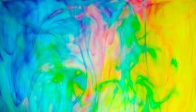 Абстрактная красочная краска в предпосылке воды Стоковое Фото