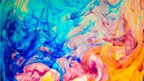 Абстрактная красочная краска в предпосылке воды Стоковое Изображение RF