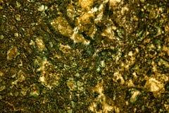 абстрактная предпосылка золотистая Минерал золота естественный Фото макроса драгоценного камня Стоковые Фото