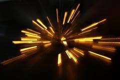 абстрактная предпосылка золотого взрыва света сделанного от движения bokeh Стоковые Фото