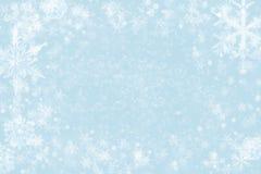 Абстрактная предпосылка рождества - яркий блеск и снежинки стоковые изображения