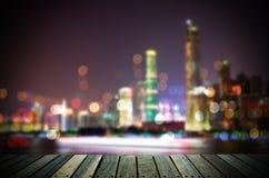 Абстрактная предпосылка городского пейзажа с деревянным полом на ноче Стоковые Фотографии RF