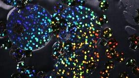 Абстрактная предпосылка, отснятый видеоматериал, multicolor кино sequins вниз движение медленное видеоматериал