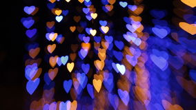 Абстрактная предпосылка с покрашенными светами в форме сердец видеоматериал