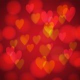 Абстрактная предпосылка с сердцами bokeh Стоковое Изображение