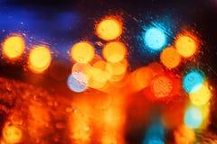 Абстрактная предпосылка с multicolor светами города ночи Стоковые Изображения