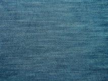 Абстрактная предпосылка текстуры ткани голубых джинсов Стоковое Изображение