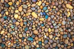 Абстрактная ровная круглая предпосылка текстуры камня моря камешков Стоковое фото RF