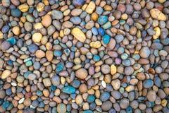 Абстрактная ровная круглая предпосылка текстуры камня моря камешков Стоковые Фотографии RF