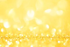 Абстрактная сияющая предпосылка bokeh праздника золота ярких блесков Стоковое Изображение RF