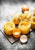 абстрактная текстура макаронных изделия еды предпосылки Варить домодельные макаронные изделия с яичком и мукой Стоковая Фотография