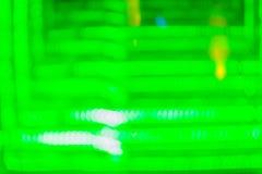 Абстрактная футуристическая зеленая предпосылка приведенная светов Моргать зеленый цвет Стоковые Изображения RF