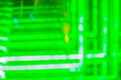 Абстрактная футуристическая зеленая предпосылка приведенная светов Моргать зеленый цвет Стоковое фото RF