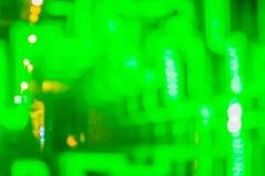 Абстрактная футуристическая зеленая предпосылка приведенная светов Моргать зеленый цвет Стоковое Изображение RF