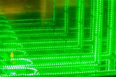 Абстрактная футуристическая зеленая предпосылка приведенная светов Моргать зеленый цвет Стоковое Изображение