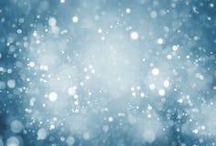 Абстрактная частица с голубой предпосылкой стоковые фото