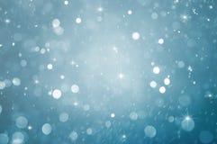 Абстрактная частица с голубой предпосылкой стоковое изображение