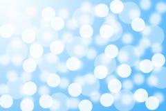 Абстрактное голубое bokeh играет главные роли предпосылка Стоковое Изображение