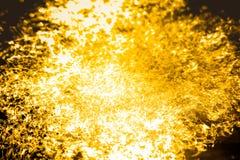 Абстрактное золото жидкости предпосылки стоковое изображение